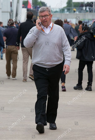 Ross Brawn on the phone as he walks through the paddock at the British F1 Grand Prix.