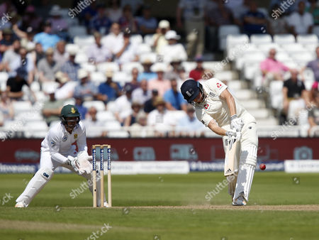 England's Jonathan Bairstow thrashes out and is caught