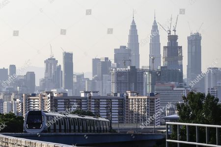 A train travels against a backdrop of the capital city of Kuala Lumpur on the second phase of the first Mass Rapid Transit (MRT) Line at Kajang, Malaysia, 17 July 2017. The Sungai Buloh ? Kajang line spans 51km and has 31 stations out of which seven are underground. Malaysian Minister of Transport Liow Tiong Lai said on press statement on 17 July, that once the Semantan ? Kajang route is fully operational, the MRT Line 1 will transport an average of 150,000 passengers a day ? a drastic increase from the 15,000 passengers currently being transported.