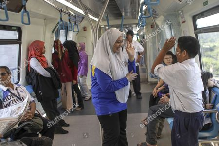 Malaysian students travel on a train on the second phase of the first Mass Rapid Transit (MRT) Line at Kajang, Malaysia, 17 July 2017. The Sungai Buloh ? Kajang line spans 51km and has 31 stations out of which seven are underground. Malaysian Minister of Transport Liow Tiong Lai said on press statement on 17 July, that once the Semantan ? Kajang route is fully operational, the MRT Line 1 will transport an average of 150,000 passengers a day ? a drastic increase from the 15,000 passengers currently being transported.