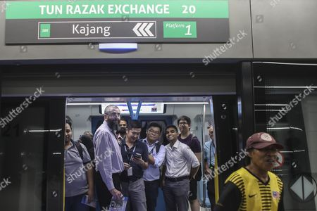 Train passengers stand inside a train on the second phase of the first Mass Rapid Transit (MRT) Line at Kajang, Malaysia, 17 July 2017. The Sungai Buloh ? Kajang line spans 51km and has 31 stations out of which seven are underground. Malaysian Minister of Transport Liow Tiong Lai said on press statement on 17 July, that once the Semantan ? Kajang route is fully operational, the MRT Line 1 will transport an average of 150,000 passengers a day ? a drastic increase from the 15,000 passengers currently being transported.