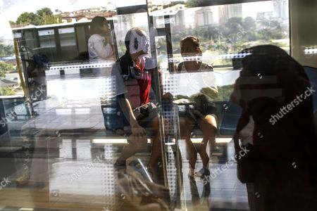 Train passengers are reflected at a train station while travelling on the second phase of the first Mass Rapid Transit (MRT) Line at Kajang, Malaysia, 17 July 2017. The Sungai Buloh ? Kajang line spans 51km and has 31 stations out of which seven are underground. Malaysian Minister of Transport Liow Tiong Lai said on press statement on 17 July, that once the Semantan ? Kajang route is fully operational, the MRT Line 1 will transport an average of 150,000 passengers a day ? a drastic increase from the 15,000 passengers currently being transported.