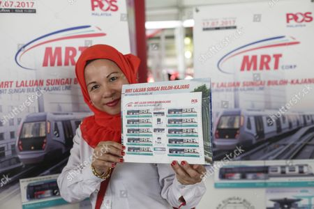 A post office officer holds a Mass Rapid Transit (MRT) Line sign during the launch of the second phase of the first Mass Rapid Transit (MRT) Line at Kajang, Malaysia, 17 July 2017. The Sungai Buloh ? Kajang line spans 51km and has 31 stations out of which seven are underground. Malaysian Minister of Transport Liow Tiong Lai said on press statement on 17 July, that once the Semantan ? Kajang route is fully operational, the MRT Line 1 will transport an average of 150,000 passengers a day ? a drastic increase from the 15,000 passengers currently being transported.