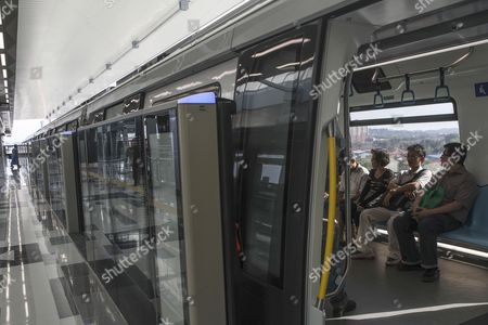 Passengers sit inside a train on the second phase of the first Mass Rapid Transit (MRT) Line at Kajang, Malaysia, 17 July 2017. The Sungai Buloh ? Kajang line spans 51km and has 31 stations out of which seven are underground. Malaysian Minister of Transport Liow Tiong Lai said on press statement on 17 July, that once the Semantan ? Kajang route is fully operational, the MRT Line 1 will transport an average of 150,000 passengers a day ? a drastic increase from the 15,000 passengers currently being transported.