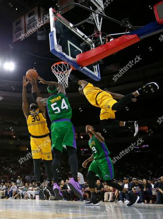 Reggie Evans, Stephen Jackson, Kwame Brown, Rashard Lewis Killer 3's Reggie Evans (30) grabs a rebound after teammate Stephen Jackson (5) misses a dunk as 3-Headed Monsters' Kwame Brown (54) and Rashard Lewis (9) defend during Game 3 in the BIG3 Basketball League in Philadelphia, Pa