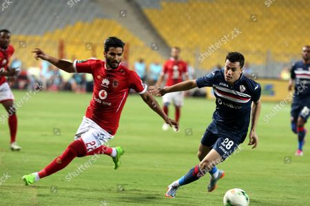 Al-Zamalek player Mahmoud Hamdy (R) fights for the ball with Al-Ahly player Saleh Gomaa  (L) during their Egyptian League soccer soccer match  at Borg El Arab Stadium in Alexandria, Egypt on in Alexandria, Egypt,  17 July 2017