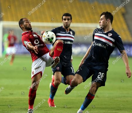 Al-Zamalek player Mohamed Nasef (C)  Mahmoud Hamdy (R) fights for the ball with Al-Ahly player Walid Souliman (L) during their Egyptian League soccer soccer match  at Borg El Arab Stadium in Alexandria, Egypt on in Alexandria, Egypt, 17 July 2017