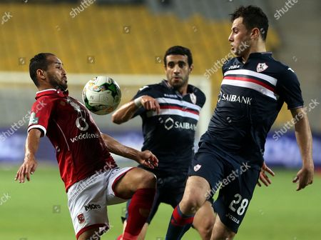 Al-Zamalek player Mohamed Nasef (C)  Mahmoud Hamdy (R) fights for the ball with Al-Ahly player Walid Souliman (L) during their Egyptian League soccer soccer match  at Borg El Arab Stadium in Alexandria, Egypt on in Alexandria, Egypt,  17 July 2017.