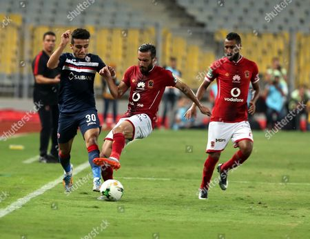 Stock Photo of Al-Zamalek player Mostafa Fathy (L) fights for the ball with Al-Ahly player Ali Malol (C) and hossam Ashour (L) during their Egyptian League soccer soccer match  at Borg El Arab Stadium in Alexandria, Egypt on in Alexandria, Egypt, on 17 July 2017.