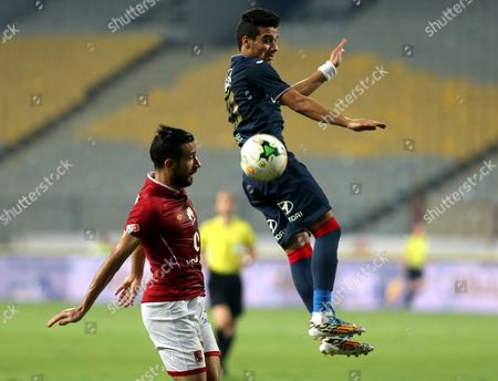 Al-Zamalek player Mostafa Fathy (R) fights for the ball with Al-Ahly player Ali Malol (L) during their Egyptian League soccer soccer match  at Borg El Arab Stadium in Alexandria, Egypt on in Alexandria, Egypt, on 17 July 2017.