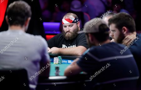 Scott Stewart, center, competes during the World Series of Poker, in Las Vegas