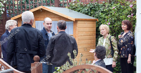 Stock Photo of Ep 8927 Sunday 19 June 2016 Kevin Webster, as played by Michael LeVell, Dev Allahan, as played by Jimmi Harkishin, Freddie, as played by Derek Griffiths, and Ken Barlow, as played by William Roache, join Tim Metcalfe, as played by Joe Duttine, in the garden at No.8 for an impromptu beer party. Sally Metcalfe, as played by Sally Dynevor, returns home with fellow councillors Paul and Helena in tow. How will they react to find Tim and his mates getting drunk in the garden?