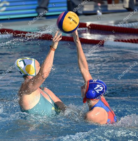 Rowie Webster (L) of Australia vies for the ball with Daria Ryzhkova of Russia during the women's water polo Group D match between Australia and Russia at the 17th FINA Swimming World Championships in Budapest, Hungary, 18 July 2017.