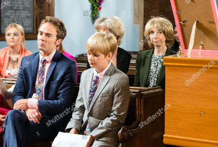 Ep 8958 Monday 1 August 2016 - 1st Ep Billy Mayhew, as played by Daniel Brocklebank, conducts Kylie's funeral and Max, as played by Harry McDermott, delivers a heartfelt eulogy. As David Platt, as played by Jack P Shepherd, heads to the graveside, he's incensed to see a wreath from Kylie's mates at the Dog & Gun. He kicks out at it angrily and Todd Grimshaw, as played by Bruno Langley, pulls him back. Todd turns on David, convinced he killed Callum.