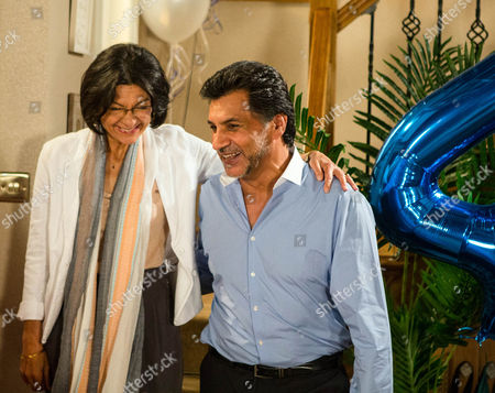 Ep 8973 Monday 22 August 2016 - 1st Ep Sharif Nazir, as played by Marc Anwar, and Yasmeen Nazir, as played by Shelley King, arrive home and are utterly thrilled to find their grandchildren have arranged a surprise 45th wedding anniversary party. Sharif makes a speech and announces to Yasmeen he's booked a holiday, the honeymoon they never had. However he's interrupted by the arrival of their old friend Sonia Rahman, as played by Sudha Bhuchar, who clearly upset, explains her husband has thrown her out. While a concerned Yasmeen heads off to make Sonia a cup of tea, grim-faced Sharif makes it clear he's unimpressed by her surprise visit.