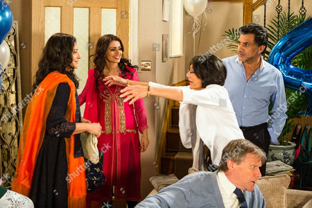 Stock Picture of Ep 8973 Monday 22 August 2016 - 1st Ep Sharif Nazir, as played by Marc Anwar, and Yasmeen Nazir, as played by Shelley King, arrive home and are utterly thrilled to find their grandchildren have arranged a surprise 45th wedding anniversary party. Sharif makes a speech and announces to Yasmeen he's booked a holiday, the honeymoon they never had. However he's interrupted by the arrival of their old friend Sonia Rahman, as played by Sudha Bhuchar, who clearly upset, explains her husband has thrown her out. While a concerned Yasmeen heads off to make Sonia a cup of tea, grim-faced Sharif makes it clear he's unimpressed by her surprise visit.