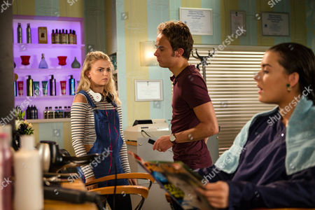 Stock Image of Ep 8986 Friday 9th September 2016 - 1st Ep Lauren, as played by Shannon Flynn, calls in the salon and finding Bethany Platt, as played by Lucy Fallon, alone, enjoys putting the frighteners on her. David Platt, as played by Jack P Shepherd, returns and Bethany floods with relief. Making out it's time they all buried the hatchet, David sends Bethany out for coffees and insists Lauren must have a free hair do. As a delighted Lauren settles back for a blow dry, David fingers the scissors in his pocket.