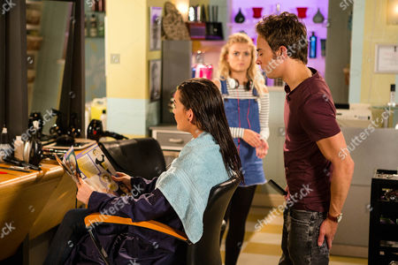 Stock Photo of Ep 8986 Friday 9th September 2016 - 1st Ep Lauren, as played by Shannon Flynn, calls in the salon and finding Bethany Platt, as played by Lucy Fallon, alone, enjoys putting the frighteners on her. David Platt, as played by Jack P Shepherd, returns and Bethany floods with relief. Making out it's time they all buried the hatchet, David sends Bethany out for coffees and insists Lauren must have a free hair do. As a delighted Lauren settles back for a blow dry, David fingers the scissors in his pocket.