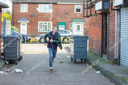 Stock Photo of Ep 8622 Monday 20 April 2014 - 2nd Ep Callum Logan, as played by Sean Ward, is stunned to find Andy Carver, as played by Oliver Farnworth, in his car and frogmarches him into the pub, demanding answers. Andy makes out he was trying to steal his car and the drugs just fell out of his pocket. Callum's having none of it and menacingly threatens Andy, until David Platt, as played by Jack P Shepherd, bursts in, admitting that he ordered Andy to plant drugs with the intention of then reporting Callum to the police. As an angry Callum vows to teach him a lesson, David does a runner. Andy arrives at his birthday party, explaining to Gail and Steph how David's in trouble. As David runs down a darkened street, he's suddenly pounced upon by Gemma, Callum and Macca who drag him towards the car!