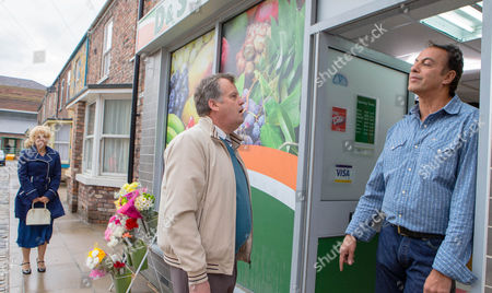 Ep 8673 Wednesday 1 July 2015 When Brian Packham, as played by Peter Gunn, finds out from Eileen that Julie Carp, as played by Katy Cavanagh, and Dev Alahan's, as played by Jimmi Harkishin, relationship is over, he's cocker hoop. Brian and Dev confront each other, each convinced the other isn't worthy of Julie. Overhearing their exchange what will Julie have to say?