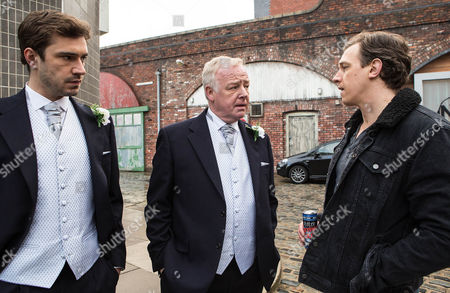 Stock Photo of Ep 8592 Monday 9 March 2015 - 1st Ep Andy, as played by Oliver Farnworth, a bag of nerves, feeling guilty about the fake mugging. Gavin Rodwell, as played by Mark Holgate, clocks Michael Rodwell, as played by Les Dennis, and Andy dressed for the service. Michael proudly explains that his son is his best man. Gavin's scathing and tells Michael that if he were his son, he'd despise him and never forgive him.