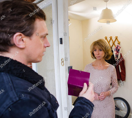 Stock Image of Ep 8592 Monday 9 March 2015 - 1st Ep As Gail McIntyre, as played by Helen Worth, prepares to leave for her wedding, Gavin Rodwell, as played by Mark Holgate, knocks on the door, introducing himself as Gavin, Michael's real son. Gail reels.