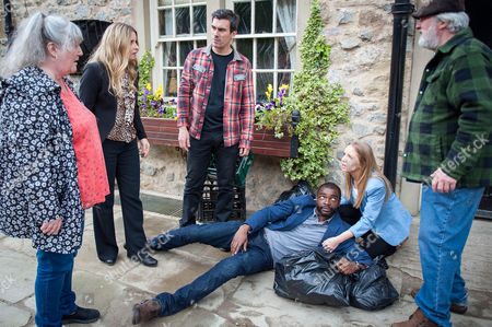 Ep 7547 Wednesday 6 July 2016  Charity Dingle, as played by Emma Atkins, and Zak Dingle, as played by Steve Halliwell, attack Bailey, as played by Micah Balfour, but Belle Dingle, as played by Eden Taylor-Draper, shouts at them to stop, announcing she's pregnant with his child and going to Romania to be with him. The Dingles are shocked Belle planned to leave without telling them but Lisa Dingle, as played by Jane Cox, warns Zak and Cain Dingle, as played by Jeff Hordley, they will have to be clever to thwart this, hatching a plan.