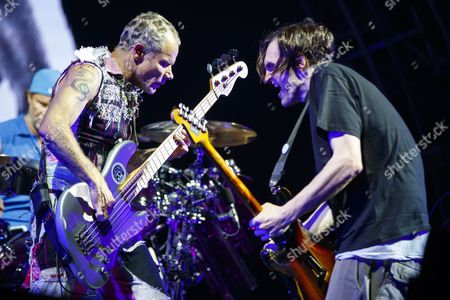 Josh Klinghoffer, right, and Flea, left, from US rock band Red Hot Chili Peppers perform onstage during the first day of the 42nd Paleo Festival, in Nyon, Switzerland, 18 July 2017. The event runs until 23 July.