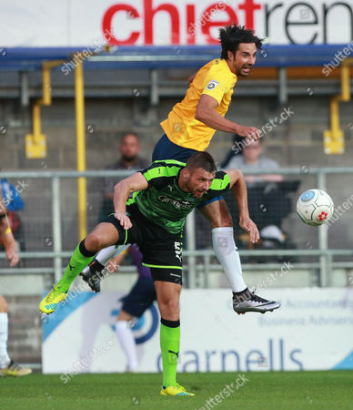 Torquay Utd's Rory Fallon challenges for the ariel ball with Plymouth's Ryan Edwards during the pre season friendly match between Torquay United and Plymouth Argyle on Tuesday 18th July 2017 at Plainmoor, Devon