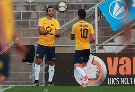 Torquay Utd's Ruairi Keating makes way for Torquay Utd's Rory Fallon during the pre season friendly match between Torquay United and Plymouth Argyle on Tuesday 18th July 2017 at Plainmoor, Devon