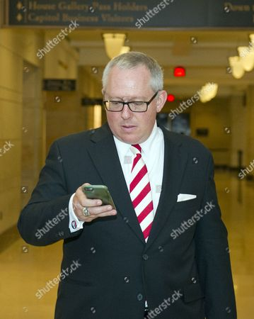 Michael R. Caputo, a Republican political strategist and media consultant, checks his phone messages as he walks through the United States Capitol following his testimony before the United States House Permanent Select Committee on Intelligence as part of their investigation into Russian interference in Washington, DC.