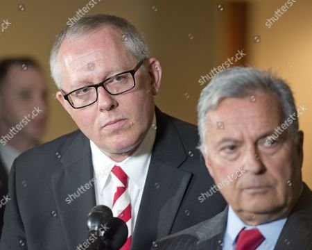 Michael R. Caputo, a Republican political strategist and media consultant, left, looks on as his attorney, former New York state Attorney General Dennis Vacco, right, makes remarks to the press in the US Capitol following his testimony before the United States House Permanent Select Committee on Intelligence as part of their investigation into Russian interference in Washington, DC.