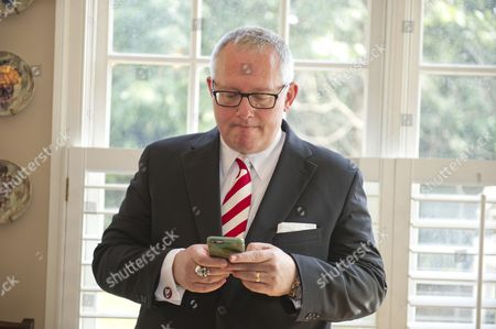 Michael R. Caputo, a Republican political strategist and media consultant, looks over his e-mails as he prepares for his testimony before the United States House Permanent Select Committee on Intelligence as part of their investigation into Russian interference in the 2016 US presidential election, on the kitchen table at the home of a long-time friend in McLean, Virginia.