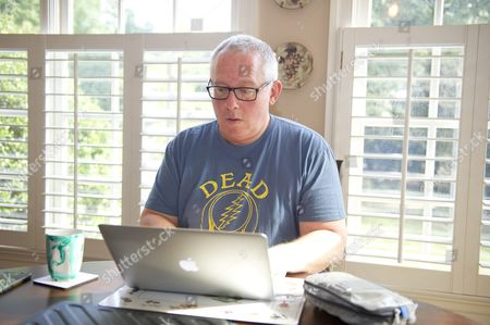 Michael R. Caputo, a Republican political strategist and media consultant, prepares for his testimony before the United States House Permanent Select Committee on Intelligence as part of their investigation into Russian interference in the 2016 US presidential election, on the kitchen table at the home of a long-time friend in McLean, Virginia.