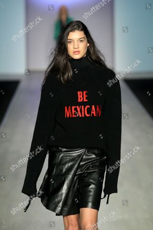 A model presents a creation by Mexican designer Ricardo Seco, with messages in favor of migration, during the runway of the Intermoda in Guadalajara, Mexico, 18 July 2017.