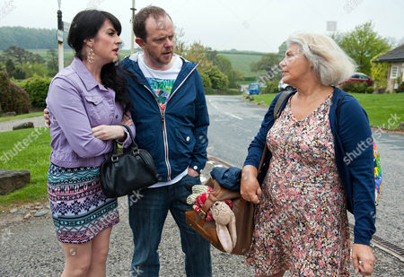 Ep 7214 Friday 19 June 2015  Whilst rushing to make a quick getaway from the village Joanie, as played by Denise Black, bumps into Kerry Norton, as played by Laura Norton, who insists she can't leave with Kyle. but Joanie maintains that Kerry is unfit to be a grandmother.