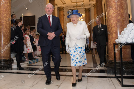Queen Elizabeth II is welcomed to Canada House in London by Canada Governor General David Johnston for her visit to celebrate Canada's 150th anniversary of Confederation