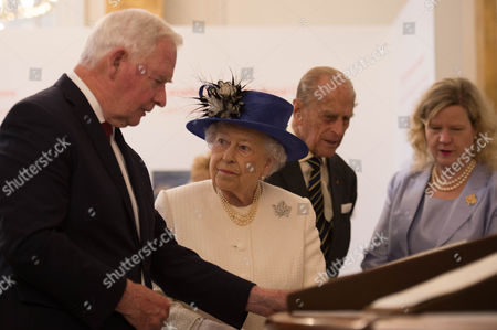Queen Elizabeth II, accompanied by Prince Philip, with Canada Governor General David Johnston during a visit to Canada House at Trafalgar Square, central London, to celebrate Canada's 150th anniversary of Confederation