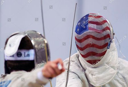 Geoffrey Loss, USA, right, fences against Richard Barnes-Webb, from South Africa, left, during a qualifier bout during the men's Sabre of the Fencing World Championship at the Leipzig Arena in Leipzig, Germany