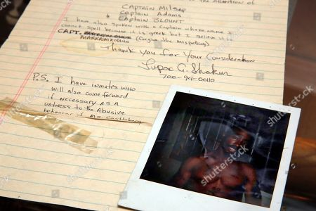 Stock Image of A Tupac Shakur two-page handwritten and signed prison letter to the deputy warden of Riker's Island Prison, and a prison Polaroid of Shakur, estimated at $60,000 to $80,000, are displayed at Gotta Have It! Collectibles, in New York, . An impending auction of pop star Madonna's personal items, including a love letter from her ex-boyfriend the late rapper Tupac Shakur, not shown, a pair of previously worn panties and a hairbrush containing her hair, was halted by a judge on Tuesday