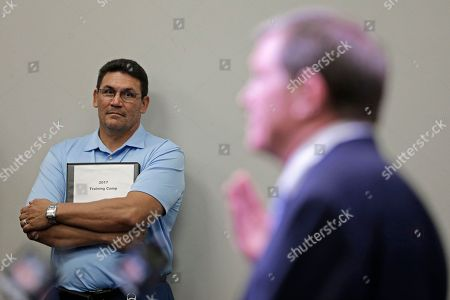 Ron Rivera, Marty Hurney Carolina Panthers head coach Ron Rivera, left, watches as interim general manager Marty Hurney speaks to the media during a news conference in Charlotte, N.C., . The Panthers rehired Marty Hurney as their interim general manager two days after owner Jerry Richardson surprisingly fired Dave Gettleman