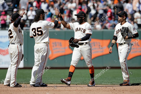 Miguel Gomez, Brandon Crawford, Denard Span, Gorkys Hernandez San Francisco Giants' Miguel Gomez, from left, Brandon Crawford, Denard Span and Gorkys Hernandez celebrate after beating the Cleveland Indians in a baseball game in San Francisco, . The Giants won 5-4
