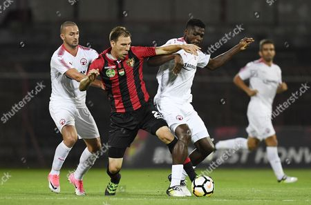 Ivan Lovric of Kispest Honved (C) vies for the ball with Ben Sahar (L) and John Ugochukwu Ogu of Hapoel Beer Sheva during the UEFA Champions League second qualifying round, second leg match between Kispest Honved and Hapoel Be'er Sheva, in Budapest, Hungary, 19 July 2017.