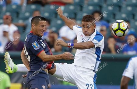 Stock Photo of Costa Rica's David Guzman (20) and Panama's Roberto Chen (23) jump for a header during a CONCACAF Gold Cup quarterfinal soccer match in Philadelphia