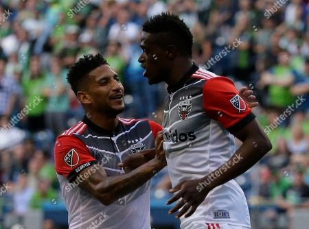 D.C. United forward Deshorn Brown, right, is greeted by defender Sean Franklin left, after Brown scored a goal against the Seattle Sounders, in the first half of an MLS soccer match, in Seattle