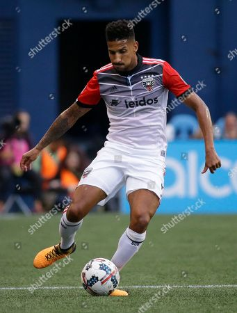 D.C. United defender Sean Franklin moves the ball against the Seattle Sounders during an MLS soccer match, in Seattle. The Sounders won 4-3
