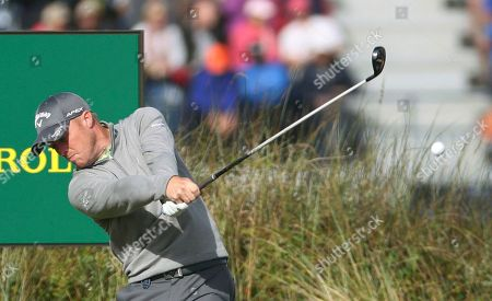 England's David Horsey plays off the 3rd tee during the first round of the British Open Golf Championship, at Royal Birkdale, Southport, England