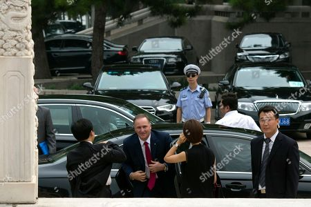 Former New Zealand Prime Minister John Key, second from left, arrives for a meeting with Chinese Premier Li Keqiang, unseen at the Zhongnanhai Leadership compound in Beijing . Key is leading a business delegation to the Chinese capital