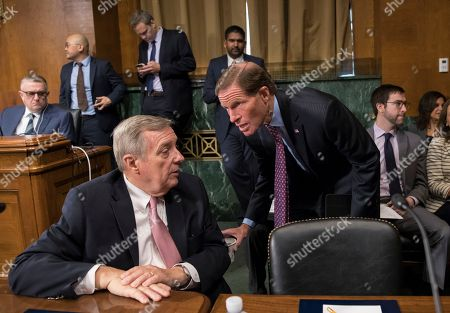 Dick Durbin, Richard Blumenthal Senator Dick Durbin, D-Ill., left, confers with Senator Richard Blumenthal, D-Conn., as the Senate Judiciary Committee meets to to advance the nomination of Christopher Wray, President Donald Trump's pick to lead the FBI, on Capitol Hill in Washington