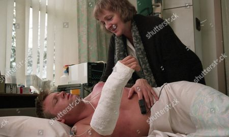 Caroline is frantic as she arrives at the hospital. Kathy tells her that Nick is not responding to treatment. If he does not regain consciousness soon, they will do a brain scan - With Nick Bates, as played by Cy Chadwick, and Caroline Bates, as played by Diana Davies. (Ep 2027 - 16th November 1995).